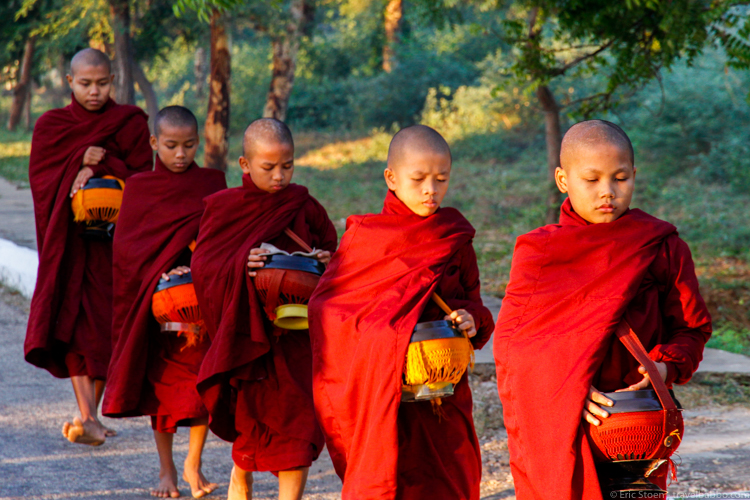 Photography trips - Myanmar Photo Trip - Young monks walking down the road in Bagan, Myanmar