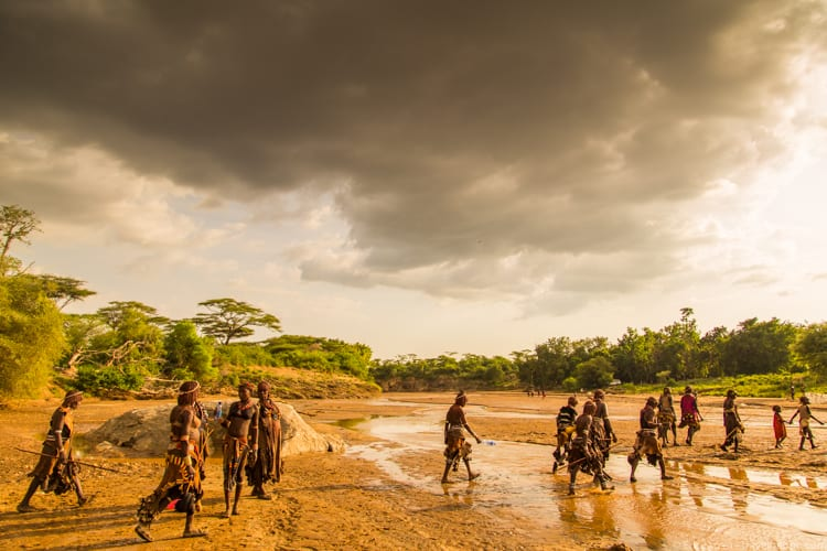 Ethiopia travel: Hamer people crossing the Keske River, heading home from the bull jumping