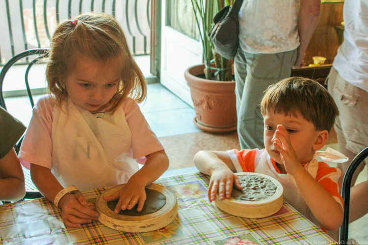 Disney port excursions - At the ceramics workshop in Palermo, Sicily. My kids' faces say it all.