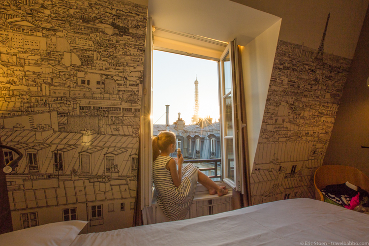 Around the world with kids - A Parisian sunset! From our room at Cler Hotel.