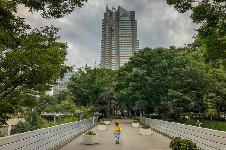Tokyo with Kids - Walking through Shinjuku Chuo Park, with the Park Hyatt straight ahead