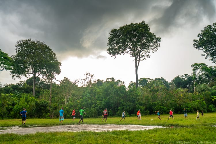 Amazon Rain Forest with Kids - Our kids playing football with the staff from the boat and the local kids