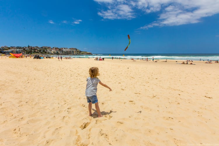 How much does a Disneyland Vacation Cost? Practicing boomerang throwing at Sydney's Bondi Beach