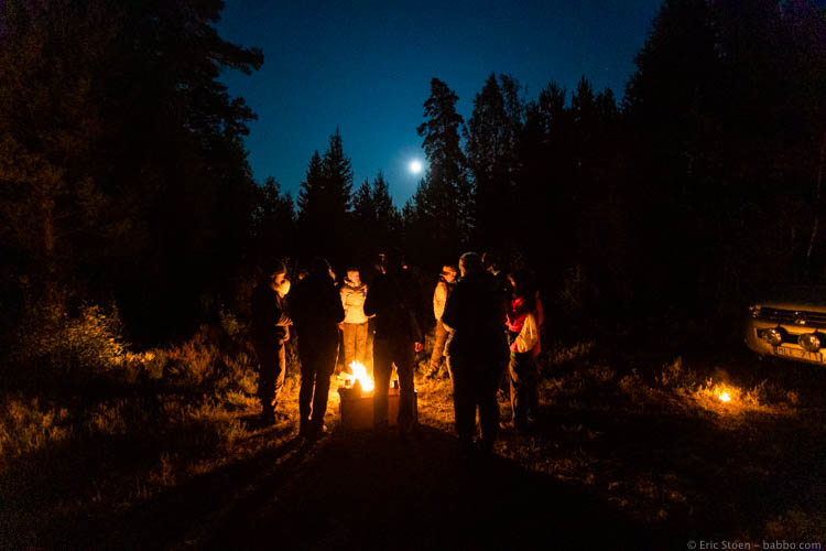 Sweden with kids - Warming up in the middle of nowhere before the wolves started to howl. No photos past this point - just memories of a magical night.
